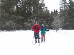 skiiers on trail